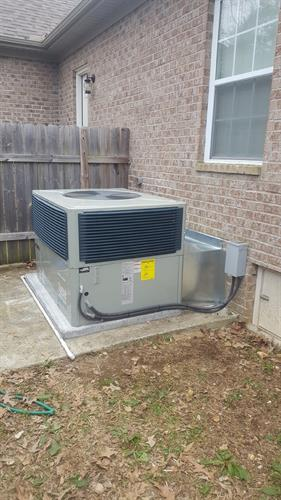 New Trane packaged heating and cooling system installation.