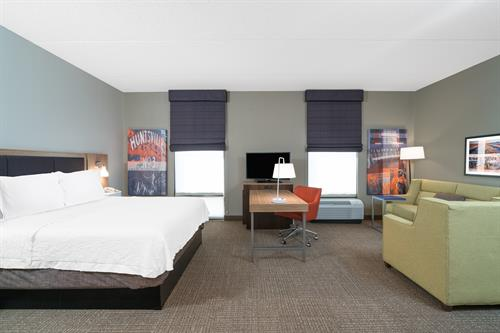 One King Bed Suite - very spacious guestroom, twice the space of standard room, similar to a studio apartment.