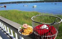 Orleans Waterfront Inns famous Lobster Roll on outdoor deck