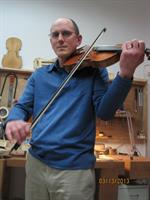 Gordon tries out Cremona violin.