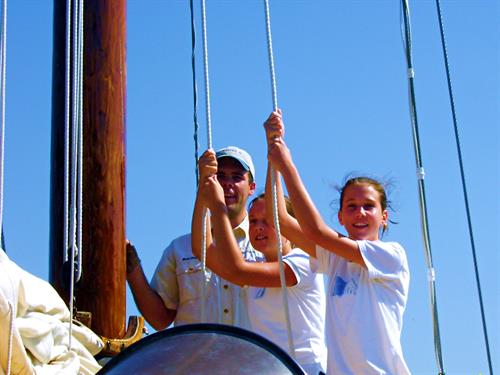 raising sails during a sailing lesson