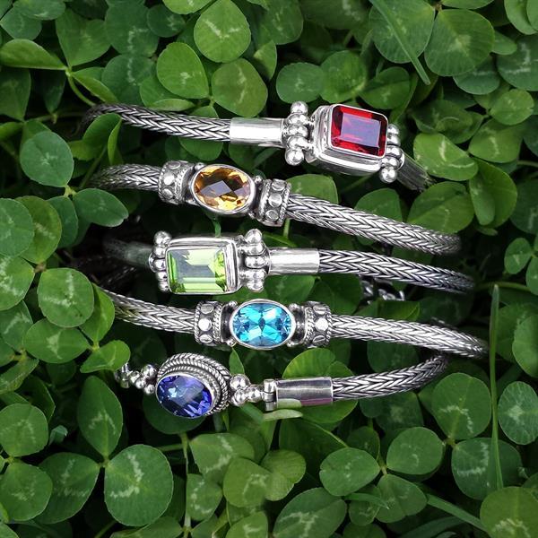 Flexible sterling silver and gemstone bracelets.