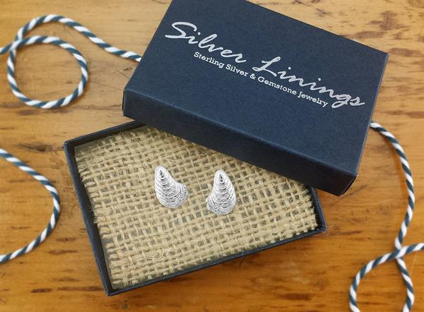Sterling silver oyster post earrings.