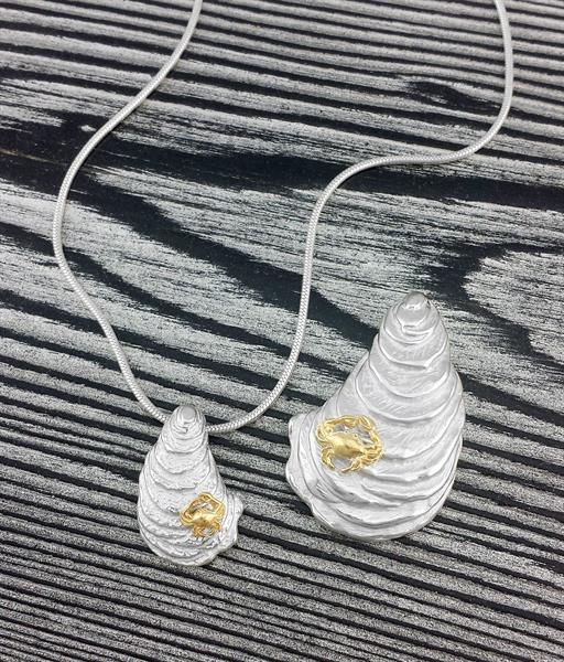 Sterling silver and gold vermeil oyster pendants.