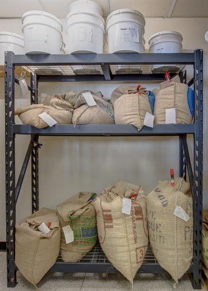 .Burlap bags filled with green coffee  beans. At any time more than 1000 pounds in stock.