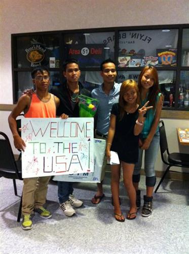 Montagnards (Vietname) at airport waiting to welcome friend they have not seen for 5 years