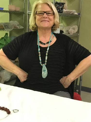 Jenny proudly dons her hand made ceramic bead necklace