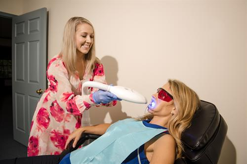 Relax while gel and light whiten your smile.