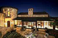 Gallery Image Horseshoe_Bay_Lakefront_Retreat_Front_Courtyard_Evening.jpg