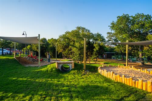 Our outdoor natural elements playscape is a great place for the kids to play, allowing both the kids and the adults to enjoy their time here.