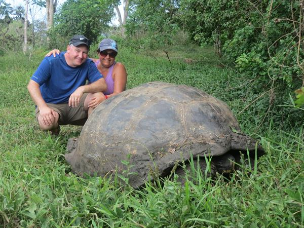 Alison meeting a Land Tortoise in the Galapagos Islands