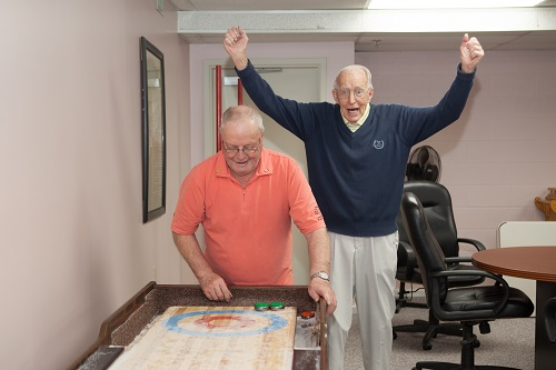Shuffleboard tables are available in many Meridian Housing Foundation complexes.