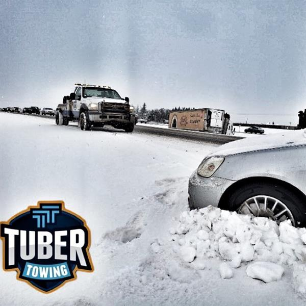 Stuck in the ditch?  Call Tuber Towing!