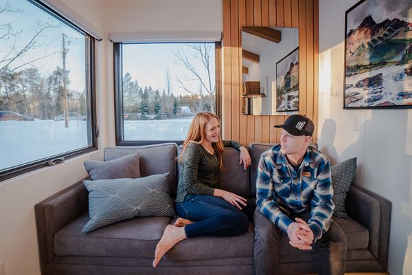 Gallery Image Fritz_Tiny_Homes_living_room_view_wih_Heather_and_Kevin_sitting_on_the_couch.JPG