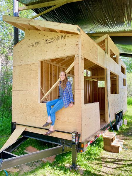 Gallery Image Heather_Fritz_with_Fritz_Tiny_Home_in_process.jpeg