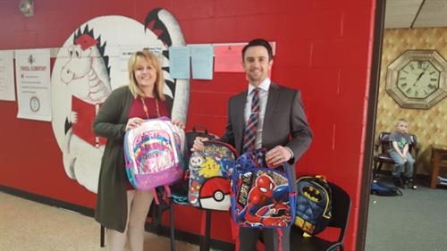 Backpack donation to Purcell Middle School