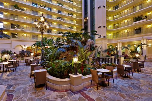 Our sun-filled 12-Story Atrium where our COMPLIMENTARY madse-to-order breakfast is served every morning.