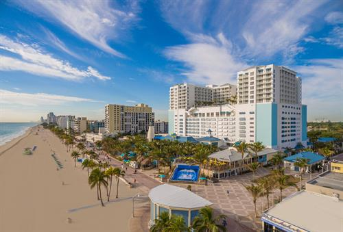 Margaritaville Hollywood Beach Resort backyard - directly sitting on legendary Hollywood Beach Broadwalk, and includes multiple restaurants, live entertainment, surf machine, retail stores and more