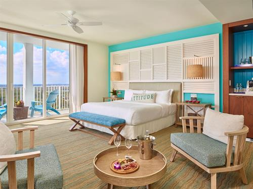 A king-bed partial ocean view junior suite within the resort. One of more than 15 separate types of guest rooms and suites within the resort.