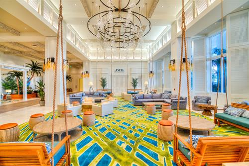 Part of the lounge area with Margaritaville Hollywood Beach Resort's Lobby contains one of the largest Margarita glass chandaliers in the world.