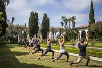 Yoga in the courtyard for a Friday Forum event featuring SWEAT Outdoors
