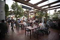 Gallery Image Loq_Patio_w_guests.jpg