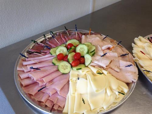 Cold Cut Platter comes with a variety of sliced breads and dressings