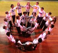 "The 6th grade performs their own choreography for ""World in Balance,"" an expression of peace."