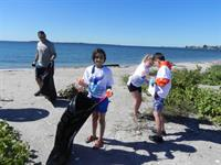 Fourth grade participates in a beach clean-up and tide pool field study each