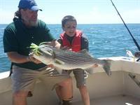 Fish is bigger than fisherman