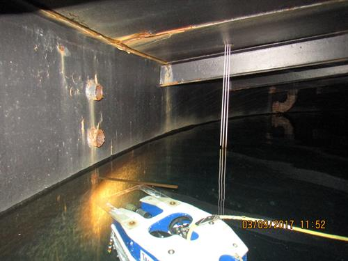 ROV vehicle performing inspection of a water storage tank while tank remains in service
