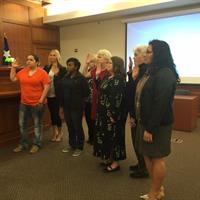 A Volunteer class being sworn in by Judge Neill