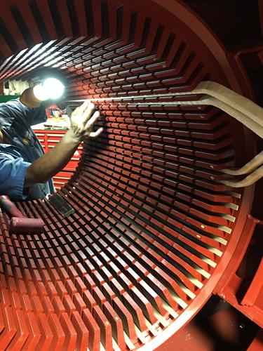 Inserting coils into a 900 Hp Stator.