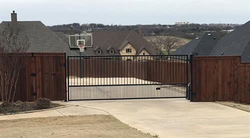 Cedar Fence with automatic iron gate
