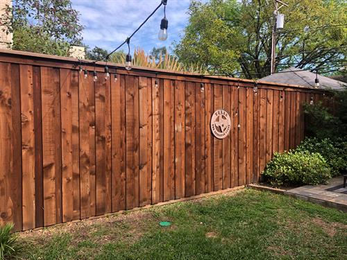 Cedar pre-stained fence with cap and trim