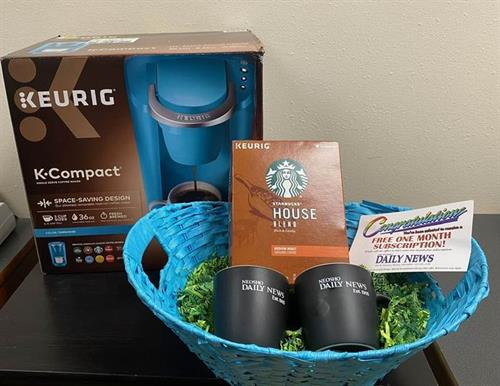 Our gift basket giveway this year - coffee and newspaper!