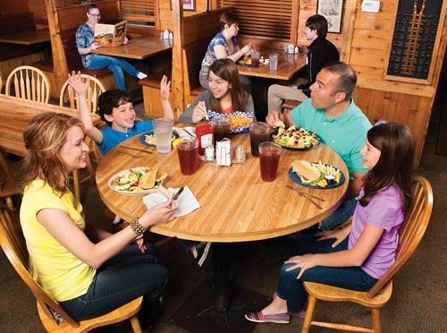 "McFarlain's family Restaurant home of the ""Rising Tables"""