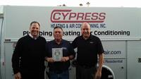 Bob - President and CEO of Cypress, receiving Lennox Centurion award.