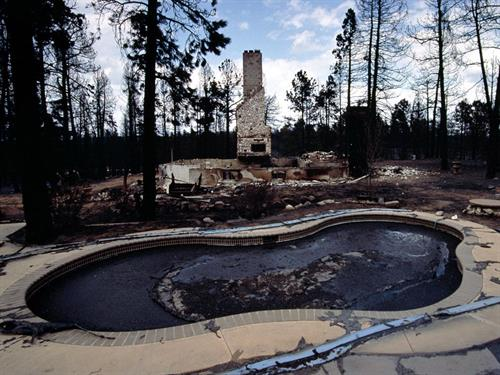 Full pool of destroyed home