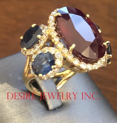 One of a kind unique ring design with Ruby and Sapphires!