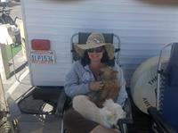 "Always with a dog on her lap at camping, someone once said to Lori, ""You are a crazy dog lady!"""