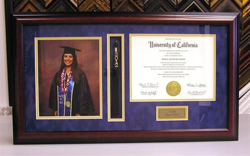 Framed diploma with tassel and photo.