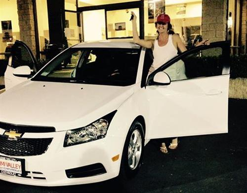 Our happy customer with her brand new Chevy Cruze!