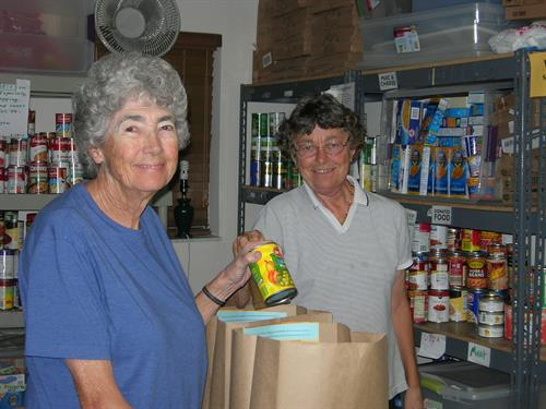Delray Food Pantry volunteers packing bags for the hungry.