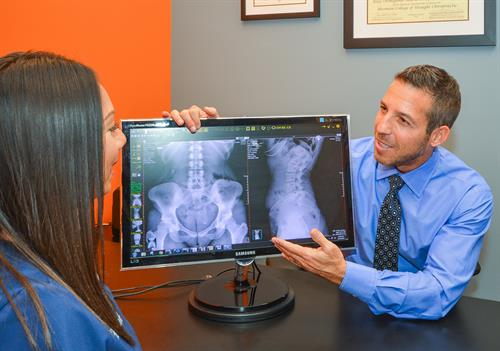 Gallery Image Dr_A_showing_xrays_BEST_with_name_gone.jpg