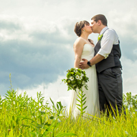 Newlyweds embrace at the Schlitz Audubon Nature Center, Bayside, WI