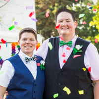 Brides with rainbow confetti, Wind Point Lighthouse, Racine, WI