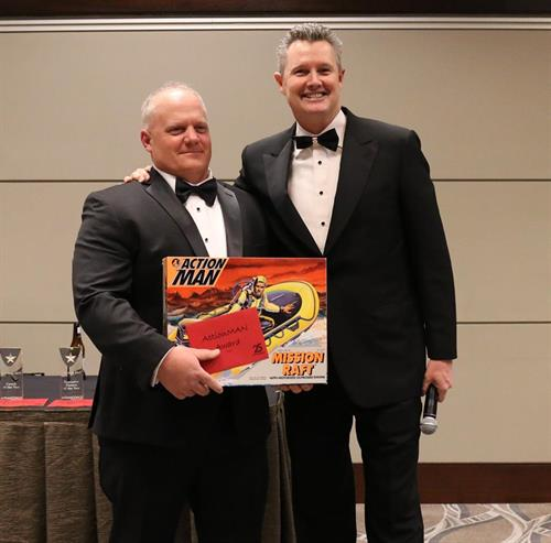 Coach Mike McKay winning the Action Man award from ActionCOACH Founder, Brad Sugars at the Business Excellence Forum and Awards, Charleston, SC February, 2019