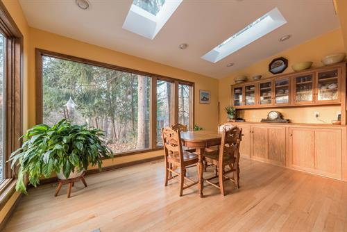 Bright and airy four season room with skylights and storage.