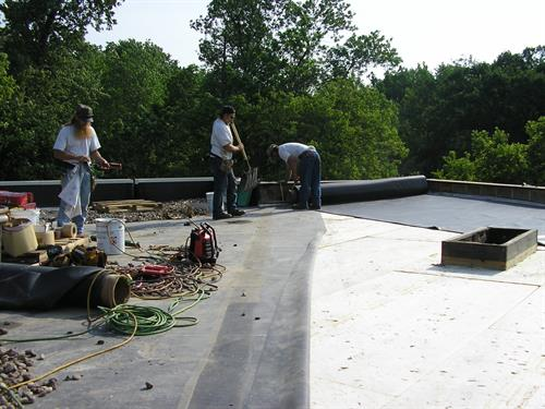 Commercial and low slop roofing including EPDM rubber roofing and hot asphalt flat roofing.